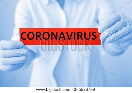 Coronavirus, Covid-19 Red Warning Sign With The Text Coronavirus In Doctor Hands In White Coat And G