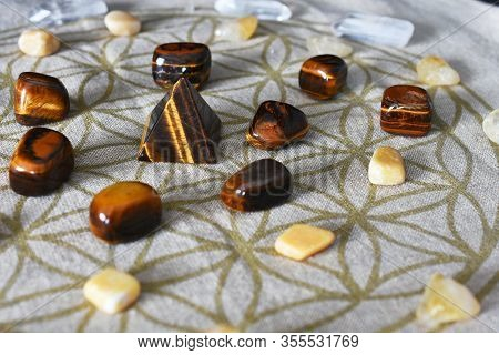 A Close Up Image Of A Prosperity Grid Using Tiger Eye And Citrine Crystals.