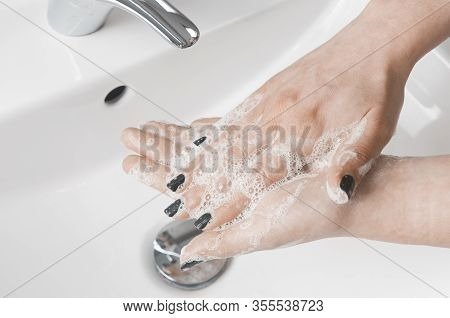 Effective Handwashing Techniques: Woman Wash Her Hands Using Palm To Palm Technique. Hand Washing Is