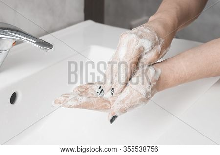 Hand Washing Techniques: Woman Rub The Palm Of Her Hand With Fingertips Of The Other Hand