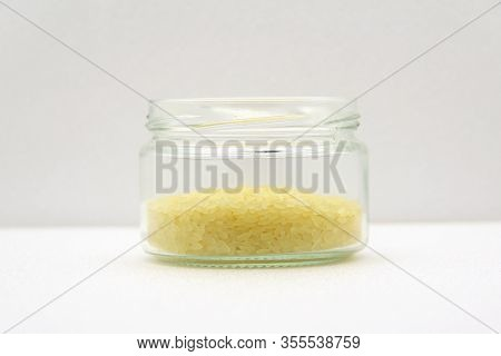 Glass Jar With Rice On A White Background, Side View. The Concept Of Healthy Nutrition, Diets, Veget