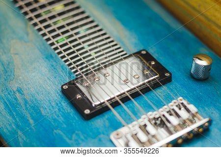 Details Of Custom Lap Steel Guitar. Strings, Pickups, Bridge, Knobs, Frets Of A Slide Guitar.