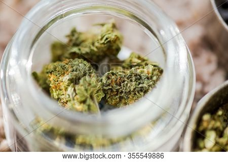 Close-up View Of Cannabis Buds In A Glass Jar. Buds Are Fresh, Dry, And Look Healthy. A Large Amount