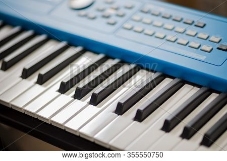 Keys Of A Blue Synthesizer. Buttons And Controls On Top Of Synth. Recording Studio Equipment. Musici