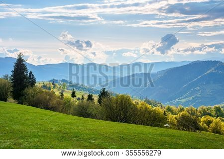 Wonderful Rural Landscape In Mountains. Fields And Meadows On Hills Rolling In To The Distant Ridge.