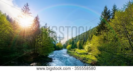 Mountain River On A Misty Sunrise. Fantastic Nature Scenery With Fog Rolling Beneath A Rainbow Above