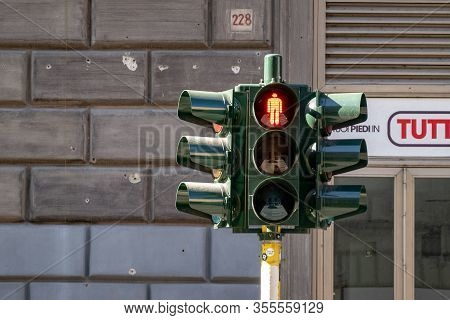 Palermo, Sicily - February 8, 2019: The Green Glossy Traffic Lights With The Red Light On For Pedest