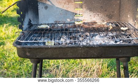 Portable Metal Grill With Charcoal. Roasted Charcoal. Barbecue Equipment. Close-up. Ash After Grill,