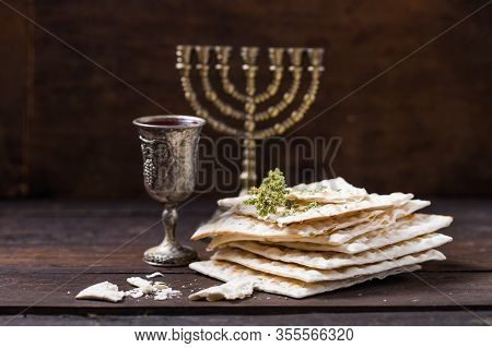 Red Kosher Wine With A White  Matzah Or Matza On A Vintage Wood Background Presented As A Passover S