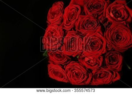 Red Rose Bouquet On A Black Background