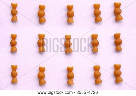 Pasta Bows Laid Out On A Pink Background