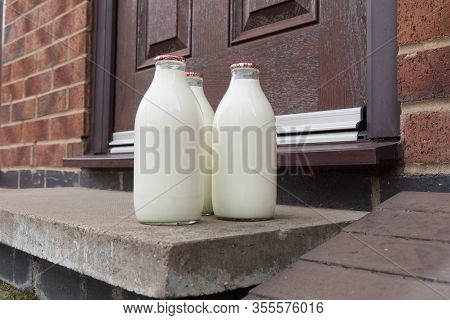 Fresh Milk In Recyclable Glass Pint Bottles Delivered To The Door Step By A Traditional Milk Man