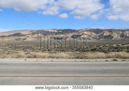 Desert Mountain Road Blue Sky Clouds Shadows
