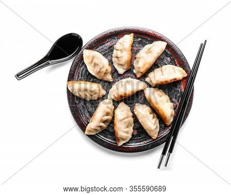 Plate With Tasty Japanese Gyoza On White Background