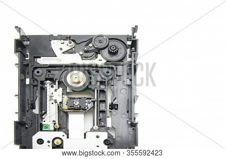 Disassembled Optical Cd-rom Drive In Black. Opened Cd Reader. Drive, Laser, Motor, Gears And Other M