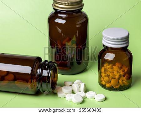 Setup Of Various White Antibiotic Medicine.different Glass Pills Bottles.