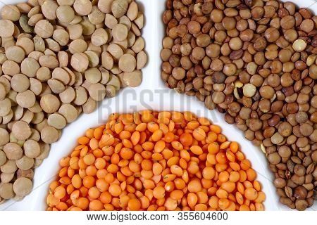 Abstract Colorful Food Background. Texture Of Lentil Grains Of Different Colors. Top View On Orange
