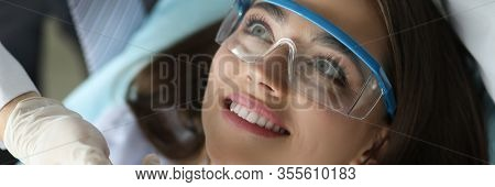 Close-up Of Smiling Beautiful Patient Visiting Annual Doctor Appointment. Wonderful Female On Examin