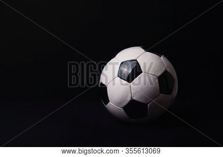 Classic Football Ball Isolated On A Black Background With Copy Space For Publicity And Advertising.