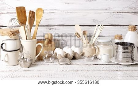 Baking Kitchenware And Baking Products On White Wooden Background. Selective Focus.