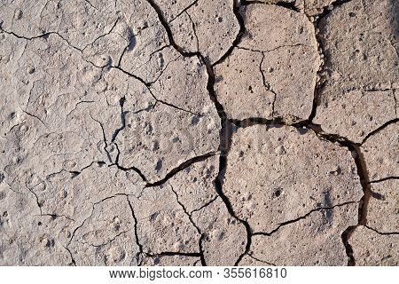 Parched Ground Of A Field In Summer During A Dry Period