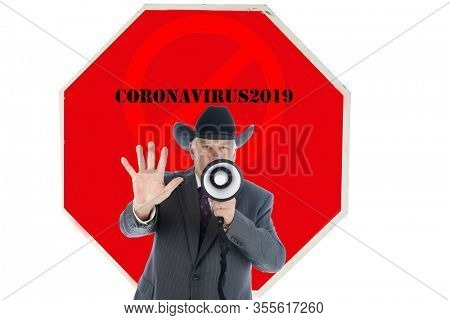 Stop Sign. Stop Coronavirus19. A man wearing a Cowboy Hat and Suit holds his hand out in a STOP Symbol and speaks into a Megaphone. Stop the COVID-19 Pandemic. Coronavirus19 is scaring people.
