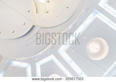 Suspended Ceiling With Led Lightspot Lamps And Drywall Construction In Empty Room In Apartment Or Ho