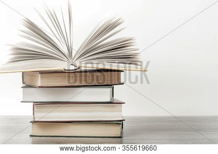 An Open Book On A Stack Of Books. The Concept Of Education , International Book Day, Success.