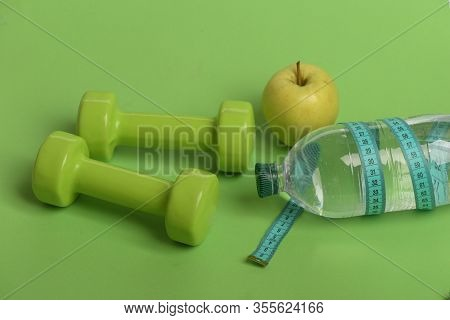 Healthy Regime Equipment. Bottle Tied With Cyan Ruler By Barbells