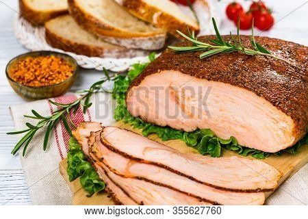 Turkey Breast Deli Roasted Sliced Cajun Style Lunch Meat On Wooden Background. Selective Focus.