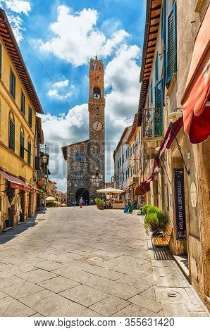 Montalcino, Italy - June 23: The Medieval Palazzo Dei Priori And The Iconic Clocktower, One Of The M