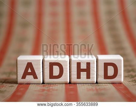 Adhd - Medical Concept. Attention Deficit Hyperactivity Disorder. Wooden Cubes On A Color Table.