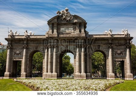The Famous Puerta De Alcala On A Beautiful Sunny Day In Madrid City. Inscription On The Pediment: Ki