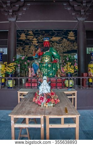 Guilin, China - May 11, 2010: Qixia Buddhist Temple In Seven Star Park. Statues Of Red-faced, Green-
