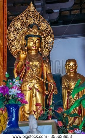 Guilin, China - May 11, 2010: Qixia Buddhist Temple In Seven Star Park. Closeup Of Golden Statue Of