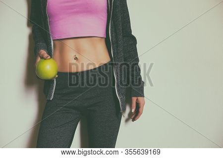 Image Of Fit Sporty Woman With Abs Holding Apple.