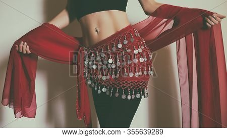 Close Up Stomach Of Belly Dancer With Scarf.
