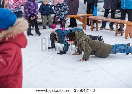 Zarinsk, Russia- February 29, 2020: Russian Folk Festival, Shrovetide, Treat Pancakes, Traditions Of