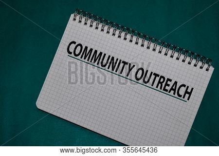 Community Outreach Write On A Book Isolated On Office Desk.