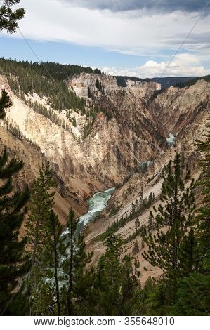 The Wild And Fast Green Water Yellowstone River Flowing Through The Colorful Steep Rocky Walls Of Th