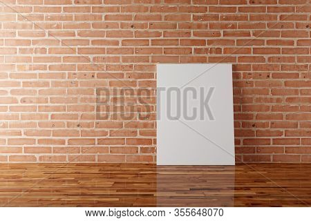 Empty Picture Frames Canvas Mock-up Leaning Against Brick Stone Wall In Room With Wooden Floor With