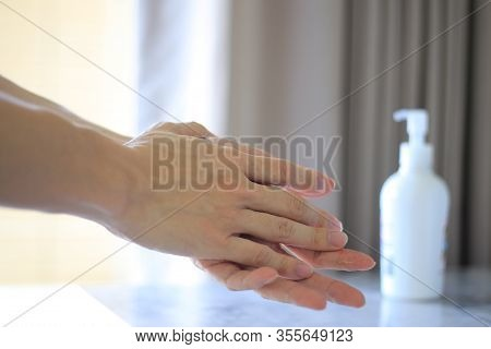Rubbing Hands With Alcohol Gel To Kill Bacteria And Viruses. Washing Hands With Sanitizer To Repel T