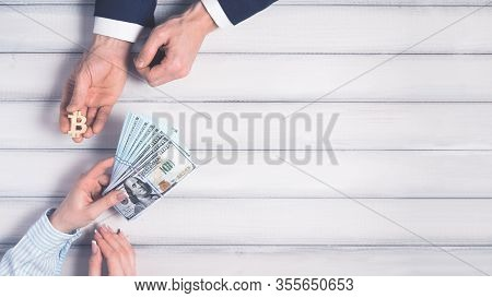 Trading Symbol. Bitcoin Buy And Sell Concept, Woman Buy Bitcoin And Pay By Dollars.