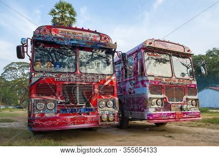 Anuradhapura, Sri Lanka - February 04, 2020: Two Painted Tourist Buses