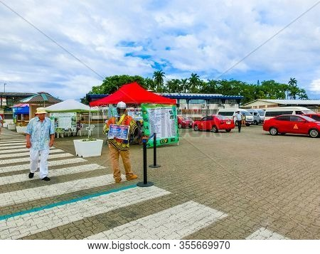 Puerto Limon, Costa Rica - December 8, 2019: The Tourists Choose A Adventure And Excursions Tour At