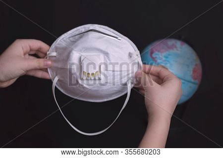 World Corona Virus Attack Concept.the Child Puts A Protective Mask On The Ground. The Concept Of Pro