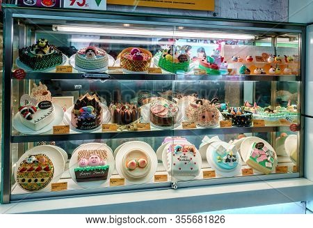 Macao, China- January 24, 2016: Illuminated Confectionary Shop Storefront With Different Kinds Of Sk