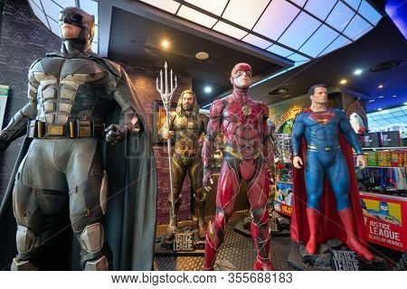 SINGAPORE - JANUARY 20, 2020: life-size statues on display at DC Comics Super Heroes Cafe at the Shoppes at Marina Bay Sands in Singapore.
