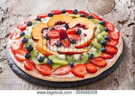 Fruit Pizza With Fruit And Berries .