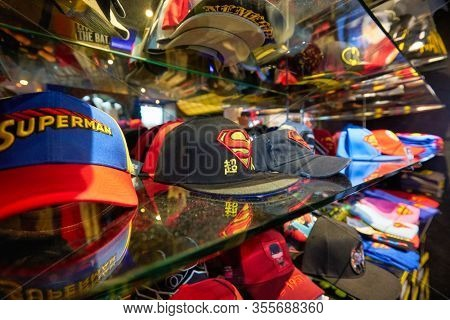 SINGAPORE - JANUARY 20, 2020: baseball caps on display in DC Comics Super Heroes Cafe at the Shoppes at Marina Bay Sands in Singapore.
